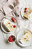 Cream cake with raspberries and pistachios