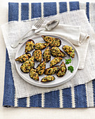 Stuffed, gratinated mussels