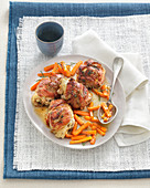 Chicken thighs in bacon with a carrot medley