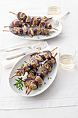 Lamb kebabs with red onions and purple potatoes