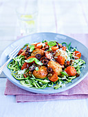 Zucchini noodles with meatballs, olives and tomatoes