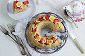 Egg white and oat wreath cake with bananas and strawberries