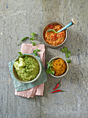 Bowls of red, green and yellow curry paste
