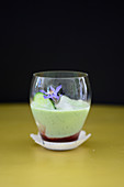 A cold cucumber and yogurt smoothie with borage blossoms