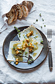 Goat's cheese carpaccio with walnuts and thyme