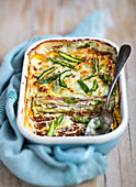 Spring lasagne with green asparagus and ham