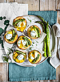 Puff pastry tarts with green asparagus and quail eggs