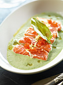 Raw marinated wild salmon on sorrel cream