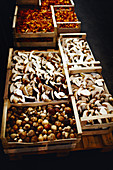 Freshly picked mushrooms at a market in wooden baskets