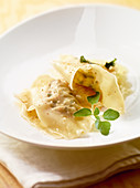 Mushroom ravioli with a white onion confit