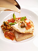 Turbot fillet on a mussel and tomato ragout