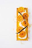 White chocolate and cardamom tart with syrupy mandarins