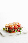 Steak sambo with beetroot pesto