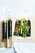 Crispy tofu brown rice nori wraps with pickled cucumber