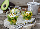 Avocado with a lime and yoghurt dip and honeyed pistachios