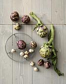 An arrangement of artichokes and quail's egg