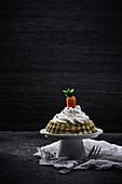 Vegan matcha vanilla cake with a marzipan carrot