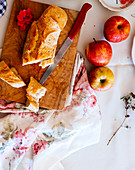 A baguette and fresh apples
