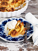 A serving of apple pie with whipped cream