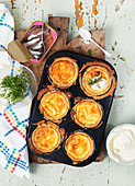 Cheese pastries with anchovies, sour cream and cress