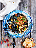 Linguine with mussels, tomatoes, parsley, chillis and grilled bread