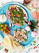 A mid-summer buffet with chicken salad, rocket, radishes and fruit salad (Sweden)