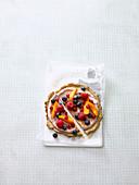 A breakfast pizza with raspberry quark