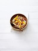 Gingerbread porridge with orange and pomegranate seeds