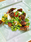 Raw marinated asparagus with pea vinaigrette and morel mushrooms