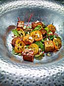 Gebratener Soja-Tofu mit Kumquats und Blutampfer