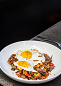 Duck hash with sunny side up eggs