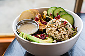 Vegetarian bowl-brown rice, acorn squash, potato, mixed greens, avocado, cranberries