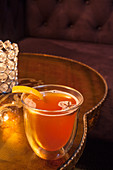 Warm whisky cocktail with orange peel and star anise
