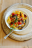 Tagliatelle with slippery Jack mushrooms and tomatoes