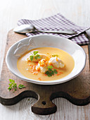 Fine potato soup with carp dumplings