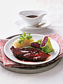 Beef loin with potato dumplings and red cabbage slices