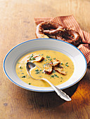 Country cheese soup with pretzel croutons