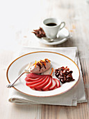 Red wine pears with chocolate cream and slivered almonds