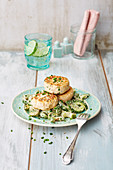 Salmon cakes on a warm cucumber salad