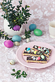 Slices of no bake Polish Easter cake (mazurek), with marzipan filling and chocolate