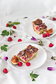 Slices of a baked millet with figs and raspberries
