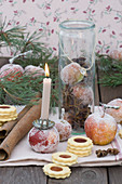 Sugared apples with candles and jam biscuits