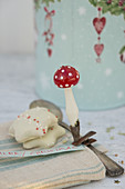 Peppernuts and a toadstool-shaped vintage Christmas tree decoration