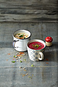 Cups of soup: coconut milk soup with dates, and beetroot soup with black salsify