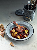 Duck leg with root vegetables and fried potatoes