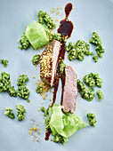 Veal topped with butter crumbs, parsley pearl barley and cabbage