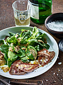 Roast beef fillets with truffles, lambs lettuce and buckwheat vinaigrette