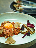 Beef tartare with truffles, anchovies and purple carrots