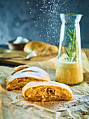 Pear strudel with rosemary sauce and tipsy cream