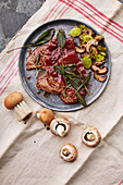 Saltimbocca with a mushroom and leek medley